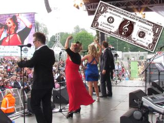 Sera (second left, video screen) rocks Hyde Park with MIB