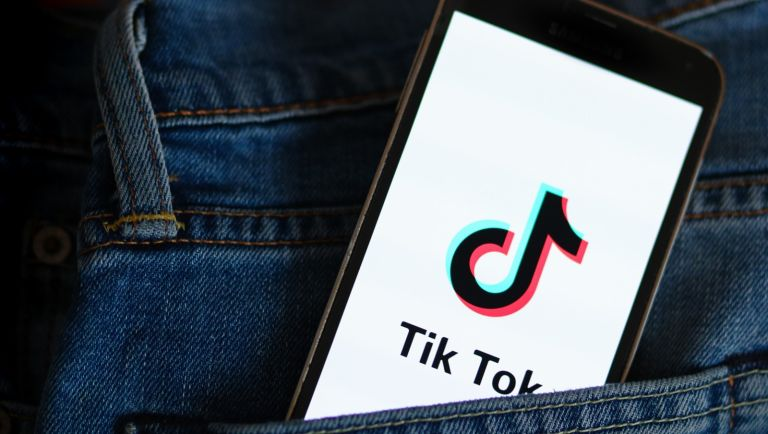 In this photo illustration, a Tik Tok logo seen displayed on a smartphone.