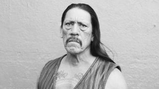 Actor Danny Trejo in a leather waistcoast