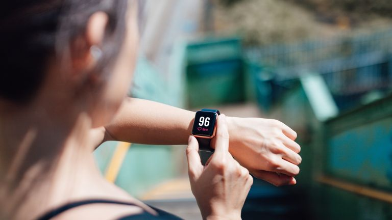 Woman checking her heart rate on a smartwatch
