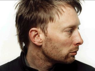 Thom Yorke looks the other way (in disgust, probably)
