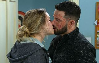 Ross, played by Michael Parr, leans in for a kiss
