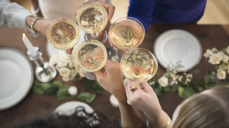 cheapest supermarket champagne and prosecco deals - group with their glasses