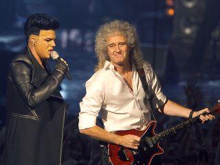 Lambert and May onstage at the MTV Europe Music Awards November 2011