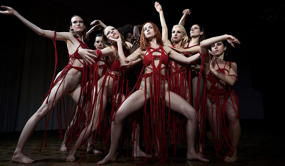 Suspiria dancers dressed in red yarn