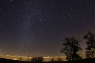 Multiple Geminid meteors streak through the sky in this photo captured by Tony Corso just south of Paris, Texas.
