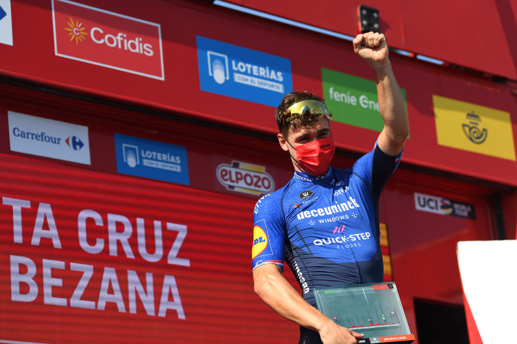 SANTA CRUZ DE BEZANA SPAIN AUGUST 31 Fabio Jakobsen of Netherlands and Team Deceuninck QuickStep celebrates at podium as stage winner during the 76th Tour of Spain 2021 Stage 16 a 180km stage from Laredo to Santa Cruz de Bezana lavuelta LaVuelta21 on August 31 2021 in Santa Cruz de Bezana Spain Photo by Tim de WaeleGetty Images