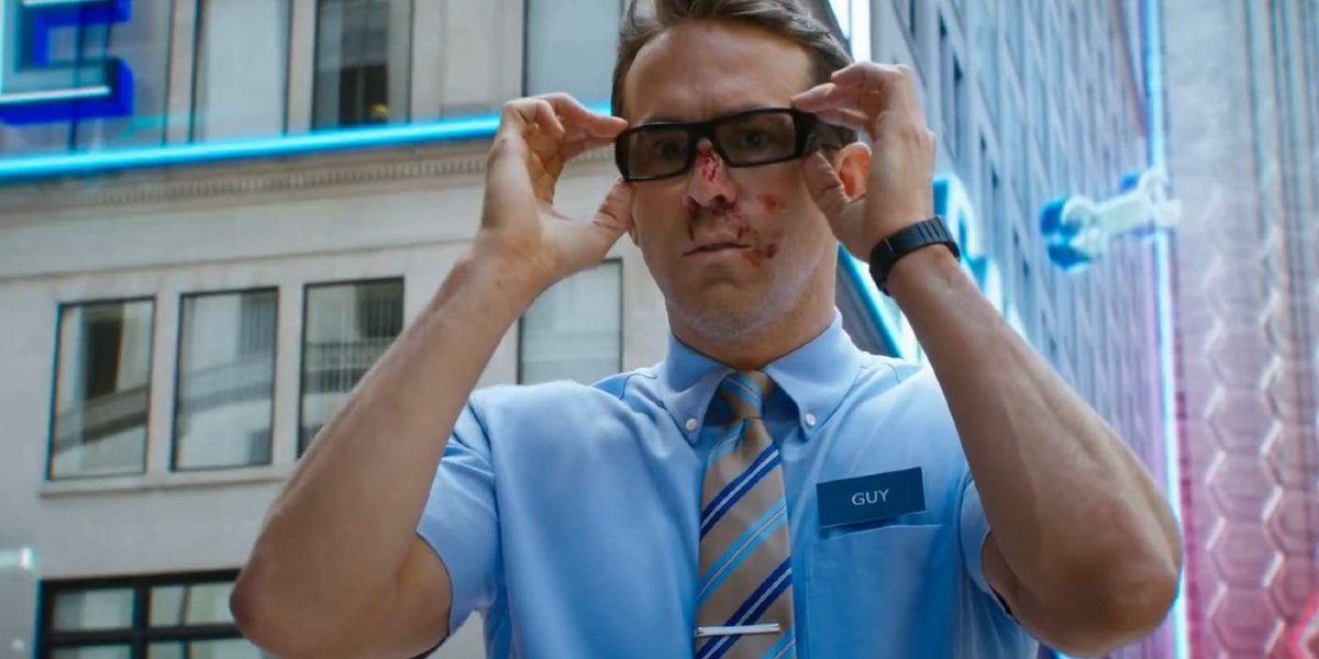 Free Guy Ryan Reynolds putting a pair of glasses on
