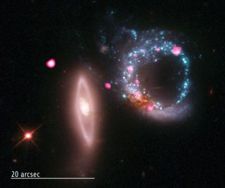 This image of the two galaxies that form Arp 147 shows a vast cosmic ring of stars (blue) and black holes (pink) as seen by the Chandra X-ray Observatory and Hubble Space Telescope. Another galaxy is also visible (vertical at left), as well as a bright st