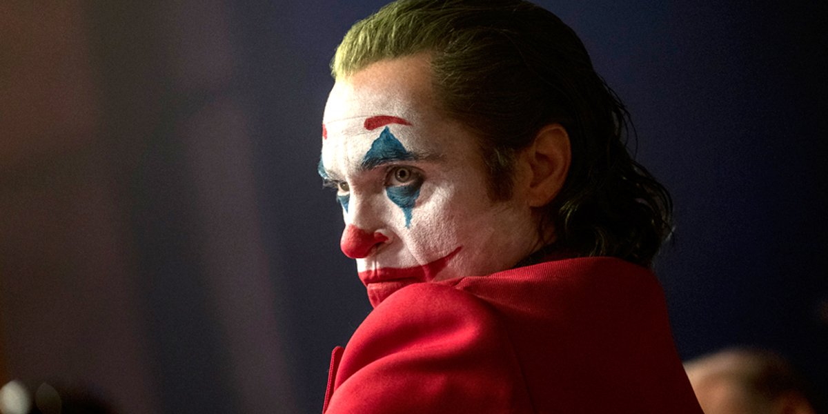 Joaquin Phoenix shows side profile in clown makeup in Joker