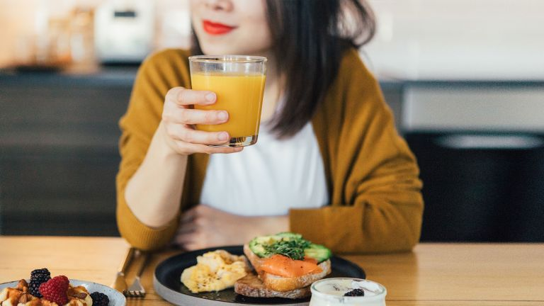 Woman eating for maximum nutritional absorption