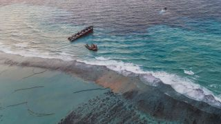 This aerial view photo taken on Aug. 17, 2020 shows the MV Wakashio vessel in two pieces near Mauritius