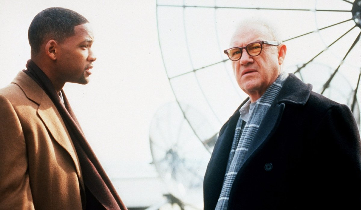 Enemy of the State a tense rooftop conversation between Will Smith and Gene Hackman