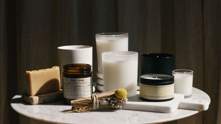 Eco-friendly fragrance: reed diffusers, candles and more on marble table