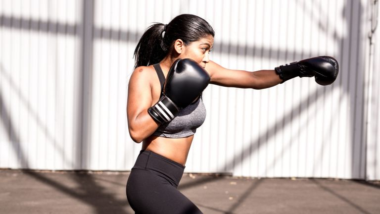 How to get a slim waist: Young woman burning fat with boxing