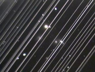 The diagonal lines stretching across this telescope image are reflected light from 25 of the first batch of Starlink satellites launched by SpaceX.