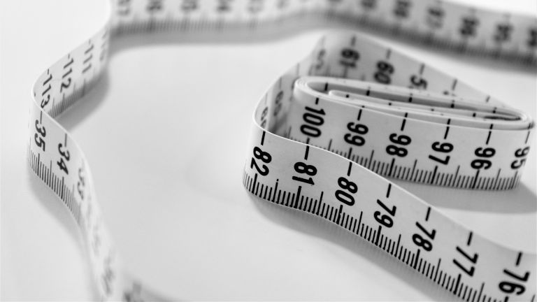 how to lose weight naturally: Tape measure