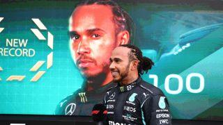 Lewis Hamilton celebrates his record-breaking 100th Grand Prix victory