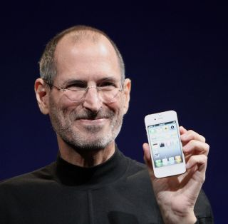 Steve Jobs shows off a white iPhone.