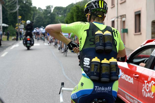Matteo Tossato carries bottles on stage eight of the 2014 Tour de France