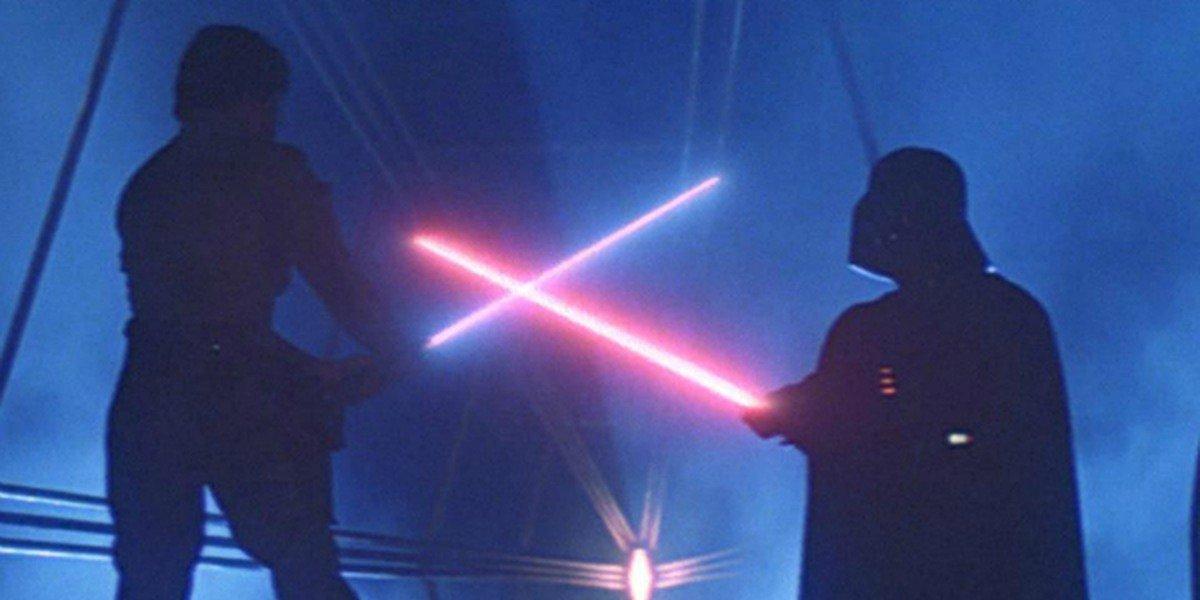 Luke Skywalker in a lightsaber duel with Darth Vader