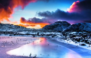 The dramatic landscape of England's Lake District is stunning whether covered in snow or sprinkled with blossoms.