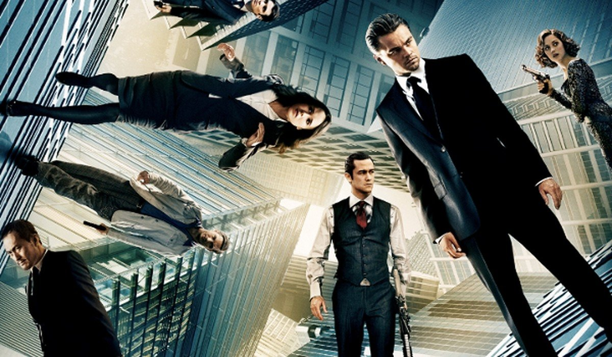 Inception the cast standing on a kaleidoscope of skyscrapers