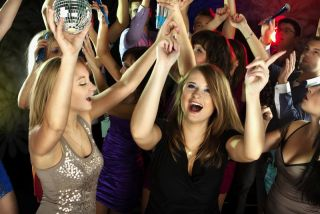 Teenagers dance at a party.