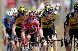 LA MANGA SPAIN AUGUST 21 Primoz Roglic of Slovenia red leader jersey and Nathan Van Hooydonck of Belgium and Team Jumbo Visma compete during the 76th Tour of Spain 2021 Stage 8 a 1737 km stage from Santa Pola to La Manga del Mar Menor lavuelta LaVuelta21 on August 21 2021 in La Manga Spain Photo by Gonzalo Arroyo MorenoGetty Images