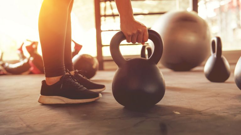 Using a kettlebell and wearing the best cross training shoes