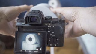 Make a working camera lens… from a roll of toilet paper!