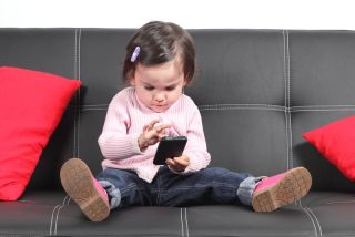 toddler playing on smartphone