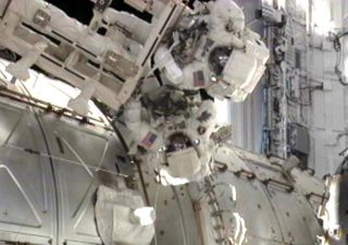 Endeavour shuttle astronauts Andrew Feustel and Mike Fincke participate in the STS-134 mission's third spacewalk as construction and maintenance continue on the International Space Station on May 25, 2011