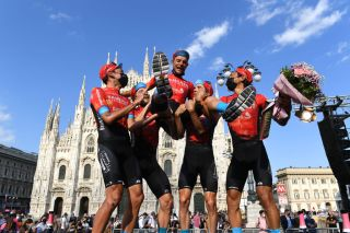 Bahrain Victorious teammates hoist Damiano Caruso after his second place in the Giro d'Italia