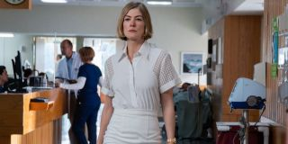Rosamund Pike walking inside a care facility in I Care A Lot