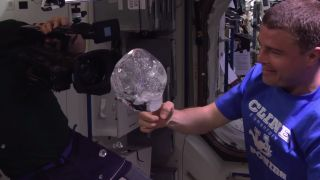 Astronauts put a GoPro inside a floating water bubble