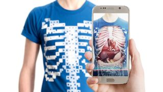 Cell phone displays skeleton and organs of chest and abdomen .