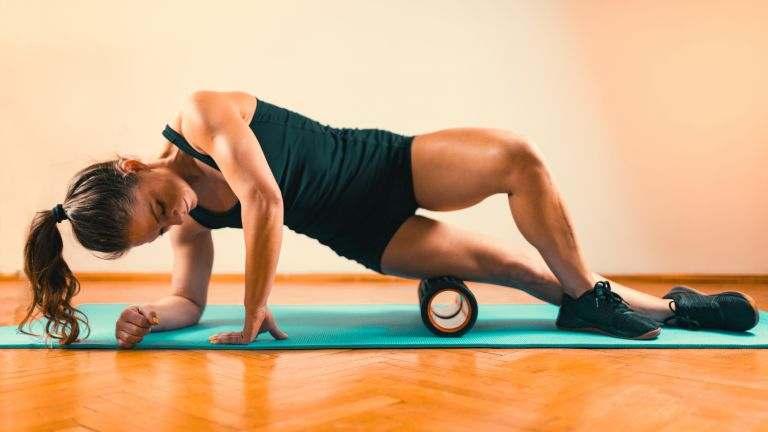 Woman using one of the best foam rollers