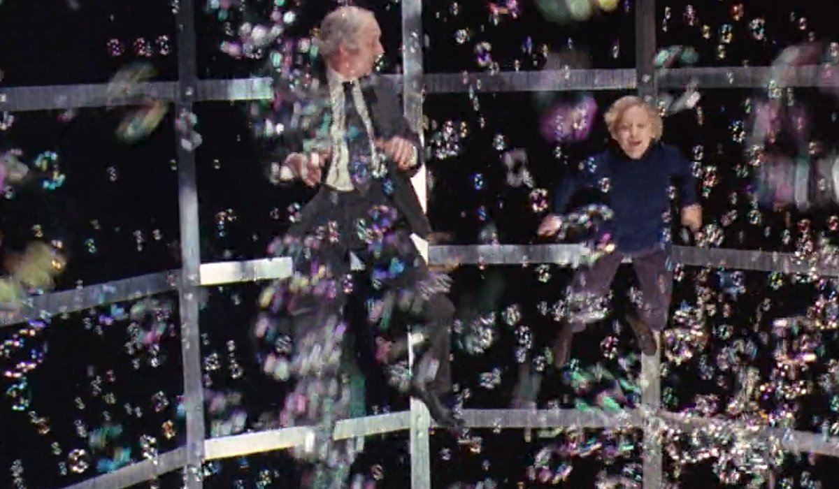 Grandpa Joe and Charlie float from fizzy lifting drinks