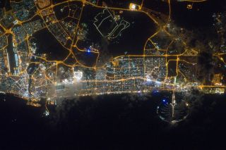 The city lights of Dubai, in the United Arab Emirates, shine in this photo taken from the International Space Station on Feb. 22, 2012.