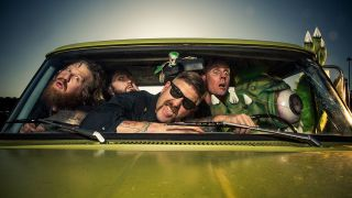 A press shot of the members of Mastodon all crowded into a car