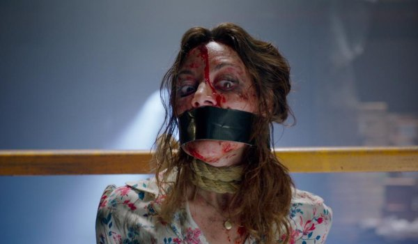 Child's Play (2019) Aubrey Plaza bound and bloody, looking frightened