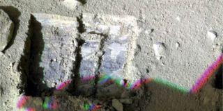 Phoenix Lander Scoops Dirt from Under Martian Rock