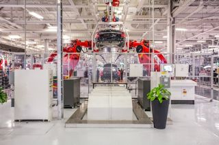 Robots at the Tesla factory in Fremont, Calif. put together electric cars.