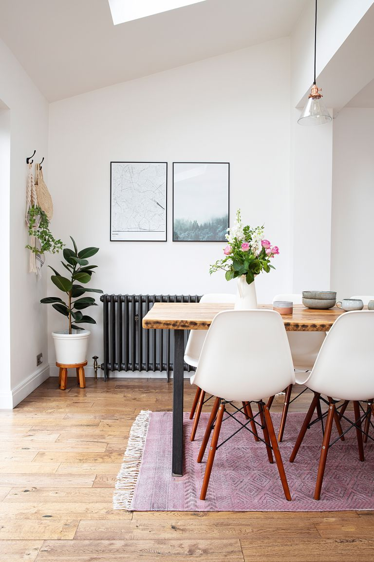 Eames chair deal: Dining area with wooden table and white dining chairs