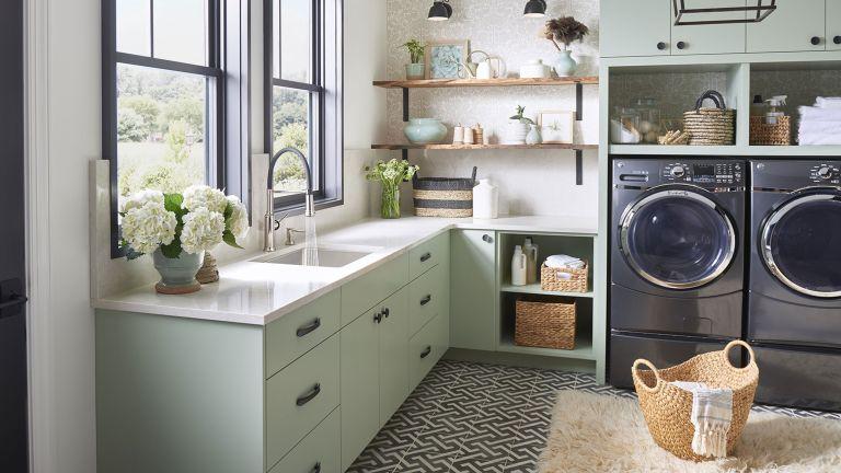blanco laundry room sink, washing machine, tumble dryer, wood shelving, rattan baskets