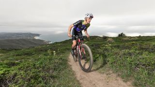 Trinity Racing's Christopher Blevins climbs above the California coast