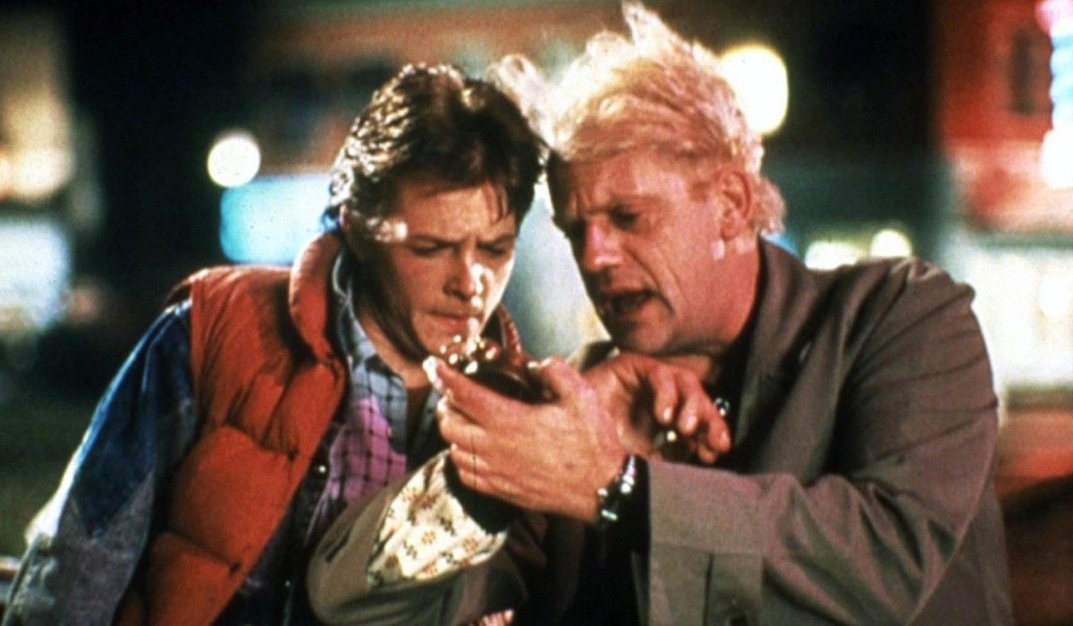 Marty and Doc checking their watches in Back To The Future.