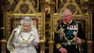 LONDON, UNITED KINGDOM - OCTOBER 14: Britain's Queen Elizabeth II (L) reads the Queen's Speech on the The Sovereign's Throne in the House of Lords next to Prince Charles, Prince of Wales (R) during the State Opening of Parliament in the Houses of Parliament on October 14, 2019 in London, England. The Queen's speech is expected to announce plans to end the free movement of EU citizens to the UK after Brexit, new laws on crime, health and the environment.
