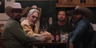 lloyd, ryan and other ranch hands in the bunkhouse on yellowstone season 3